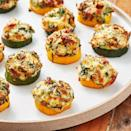 """<p>These little guys are scary addictive. Just as the courgette becomes tender, the cheese is getting melty and delicious. If you want a little extra colour on your bites, switch the oven to grill on medium and cook them a couple minutes more.</p><p>Get the <a href=""""https://www.delish.com/uk/cooking/recipes/a33664100/spinach-artichoke-zucchini-bites-recipe/"""" rel=""""nofollow noopener"""" target=""""_blank"""" data-ylk=""""slk:Spinach Artichoke Courgette Bites"""" class=""""link rapid-noclick-resp"""">Spinach Artichoke Courgette Bites</a> recipe.</p>"""