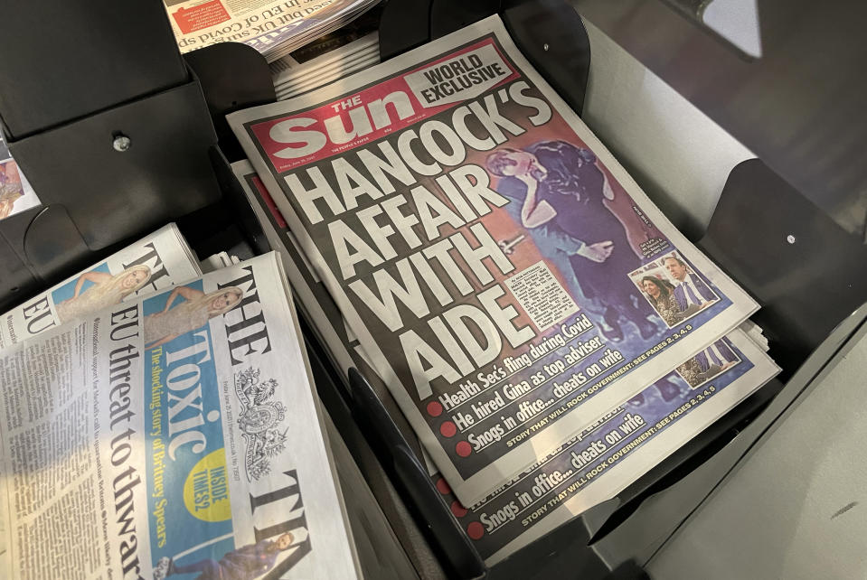 LONDON, ENGLAND - JUNE 25:  A view of copies of the Sun newspaper on a newsstand on June 25, 2021 in London, England. The paper has run an exclusive that suggests the Health Secretary Matt Hancock had an affair with his adviser Gina Coladangelo, and broke Covid-19 social distancing rules. The Prime Minister has reportedly accepted an apology after the The Health Secretary admitted breaking social distancing guidance and considers the matter closed.  (Photo by Dan Kitwood/Getty Images)