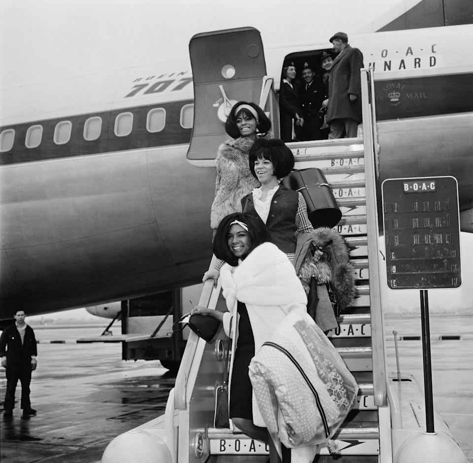"<p>The Supremes, whose hits included ""Where Did Our Love Go?<em>""</em> and ""Baby Love,"" land in London in 1965 as part of the Tamla-Motown Revue tour looking like a chic trio of travelers, thanks to their fur coats, wraps, and valises. <br></p>"