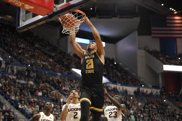 Wichita State's Jaime Echenique dunks in the second half of an NCAA college basketball game against Connecticut, Sunday, Jan. 12, 2020, in Hartford, Conn. (AP Photo/Jessica Hill)