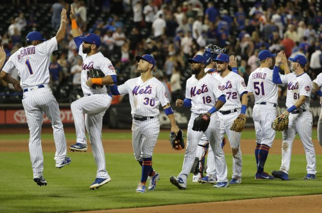 New York Mets' Amed Rosario (1) celebrates with Jose Bautista as Michael Conforto (30), Austin Jackson (16) and Paul Sewald (51) join them after a baseball game against the San Francisco Giants on Wednesday, Aug. 22, 2018, in New York. The Mets won 5-3. (AP Photo/Frank Franklin II)