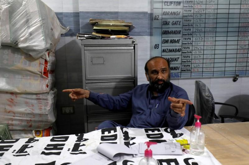 Faisal Edhi, head of the Edhi Foundation, a non-profit social welfare programme, gestures as he speaks with Reuters, following an outbreak of coronavirus disease (COVID-19) in Pakistan, at his office in Karachi, Pakistan