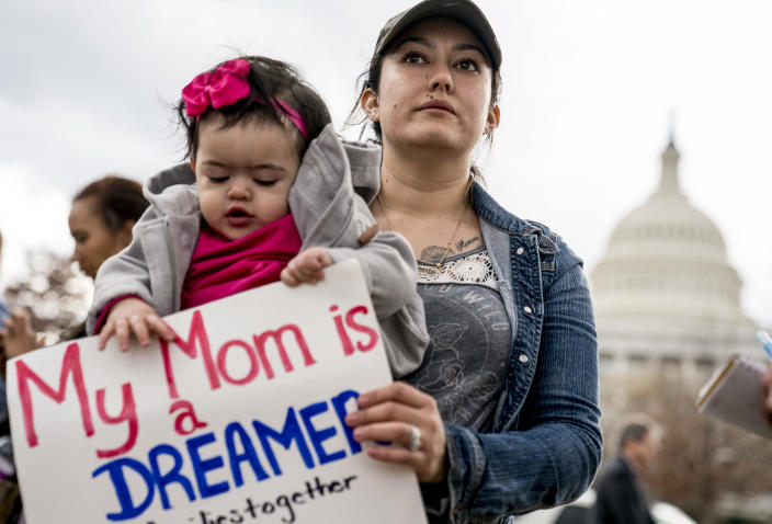 <p>Yesenia Aguilar of Reading, Penn. holds her one year old daughter Denalli Urdaneta at an immigration rally on Capitol Hill in Washington, Tuesday, Jan. 23, 2018. (Photo: Andrew Harnik/AP) </p>