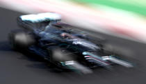 Mercedes driver Lewis Hamilton of Britain steers his car during qualification for the Formula One Portuguese Grand Prix at the Algarve International Circuit in Portimao, Portugal, Saturday, Oct. 24, 2020. The Formula One Portuguese Grand Prix will take place on Sunday. (Jorge Guerrero, Pool via AP)