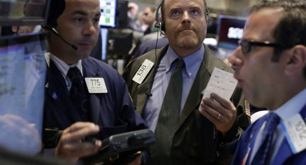Trader Andrew O'Connor, center, works on the floor of the New York Stock Exchange, Tuesday, Aug. 27, 2013. Worries about a potential military strike against Syria are dragging down the U.S. stock market in early trading. (AP Photo/Richard Drew)