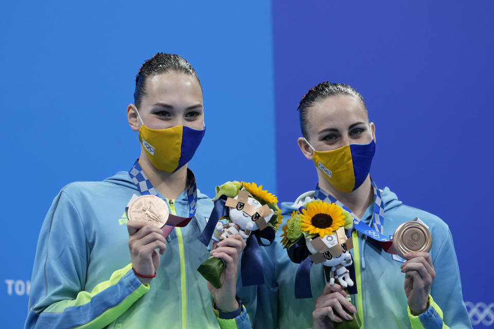 Marta Fiedina and Anastasiya Savchuk of Ukraine shows their medals during the medal ceremony of the duet free routine final at the the 2020 Summer Olympics, Wednesday, Aug. 4, 2021, in Tokyo, Japan. (AP Photo/Alessandra Tarantino)