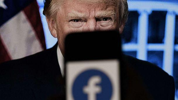 PHOTO: In this photo illustration, a phone screen displays a Facebook logo with the official portrait of former President Donald Trump on the background, on May 4, 2021, in Arlington, Va. (Olivier Douliery/AFP via Getty Images)