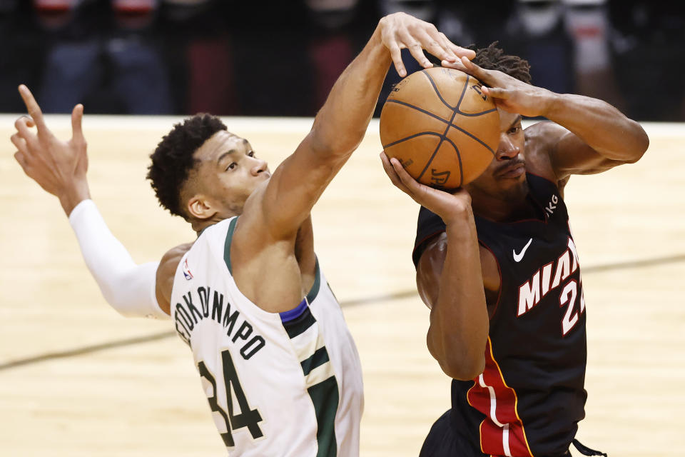 MIAMI, FLORIDA - MAY 27: Giannis Antetokounmpo #34 of the Milwaukee Bucks defends a shot by Jimmy Butler #22 of the Miami Heat during the second quarter in Game Three of the Eastern Conference first-round playoff series at American Airlines Arena on May 27, 2021 in Miami, Florida. NOTE TO USER: User expressly acknowledges and agrees that, by downloading and or using this photograph, User is consenting to the terms and conditions of the Getty Images License Agreement. (Photo by Michael Reaves/Getty Images)