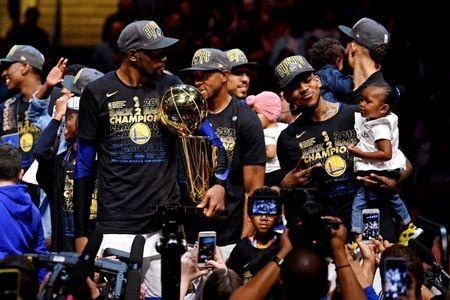 Jun 8, 2018; Cleveland, OH, USA; Golden State Warriors forward Kevin Durant (35) celebrates with the Larry O'Brien Championship Trophy after beating the Cleveland Cavaliers in game four of the 2018 NBA Finals at Quicken Loans Arena. Mandatory Credit: Kyle Terada-USA TODAY Sports