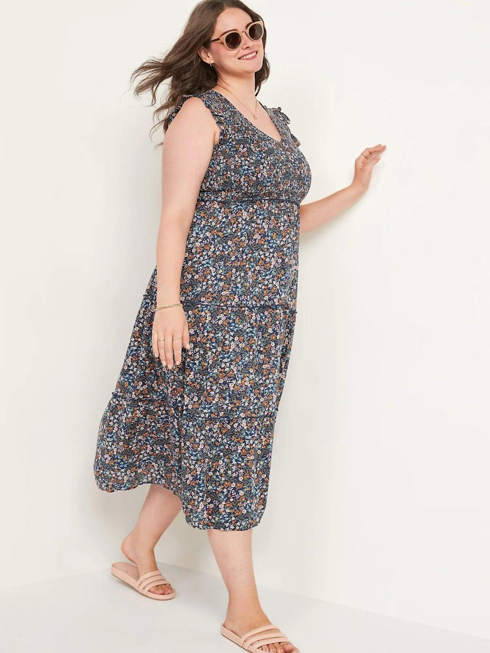 <p>This <span>Old Navy Fit &amp; Flare Smocked Floral Maxi Dress</span> ($50) is a fall floral, and we are here for it. Pair it with a cardigan for crisp fall days.</p>