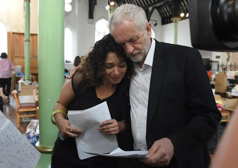 Jeremy Corbyn comforts a local resident