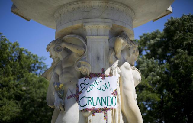<p>A sign is posted on the fountain at Dupont Circle in support of the victims of the massacre at a Orlando nightclub, after LGBT pride festival organizers held a moment of silence for shooting victims, June 12, 2016 in Washington. (AP Photo/Pablo Martinez Monsivais) </p>