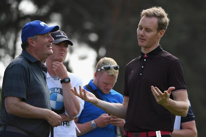 Piers Morgan chats with Dan Walker during the Pro Am for the BMW PGA Championship at Wentworth on May 23, 2018 in Virginia Water, England. (Photo by Ross Kinnaird/Getty Images)