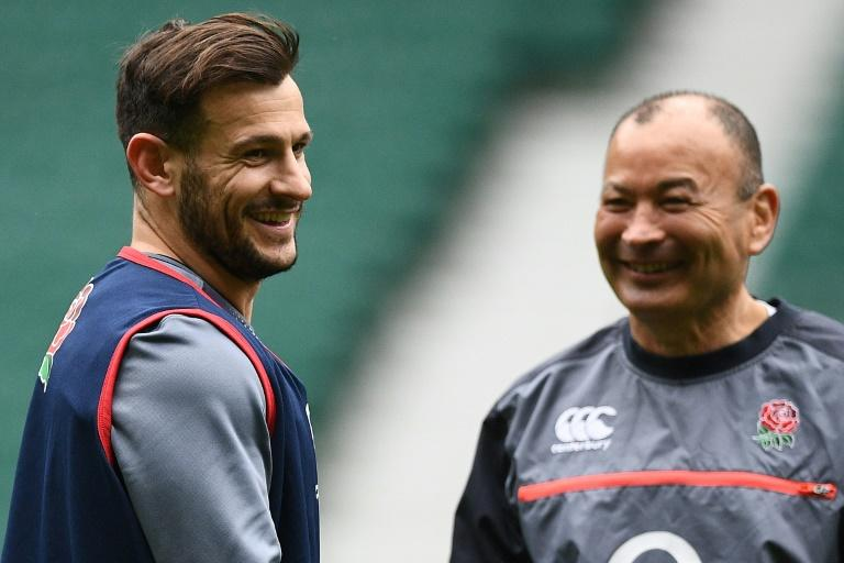England's coach Eddie Jones (R) and scrum-half Danny Care attend a training session at Twickenham stadium in London, on March 10, 2017
