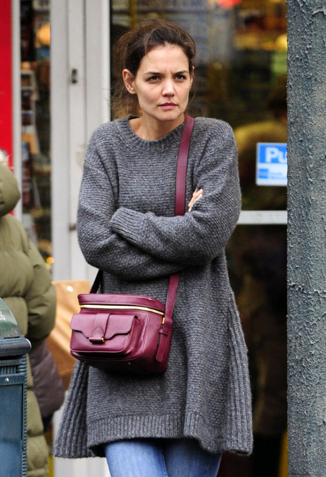 Katie Holmes shivers in the cold while out in New York City.