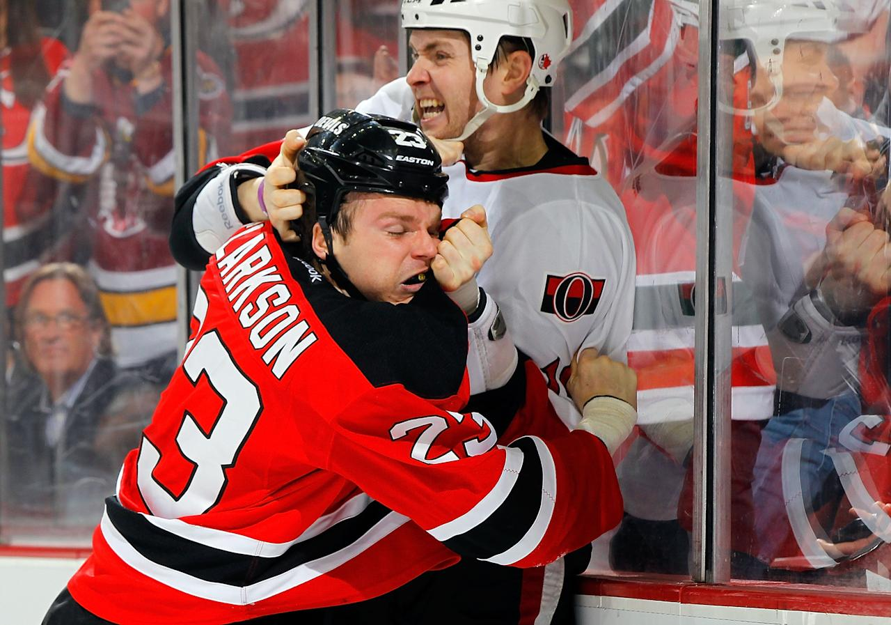 NEWARK, NJ - APRIL 12:  David Clarkson #23 of the New Jersey Devils fights Zack Smith #15 of the Ottawa Senators in the second period at the Prudential Center on April 12, 2013 in Newark, New Jersey.  (Photo by Jim McIsaac/Getty Images)
