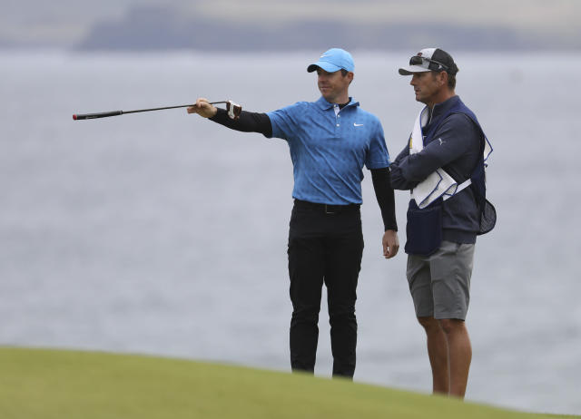 Northern Ireland's Rory McIlroy points with his club on the 5th green during the first round of the British Open Golf Championships at Royal Portrush in Northern Ireland, Thursday, July 18, 2019.(AP Photo/Peter Morrison)