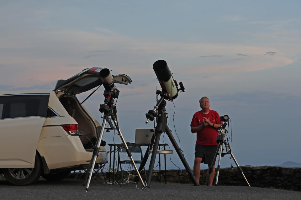 Astrophotographer and amateur astronomer Johnny Horne gazes into the northern sky as he prepares to photograph Comet NEOWISE at Grandfather Mountain in Linville, N.C., Friday, July 17, 2020. (AP Photo/Gerry Broome)