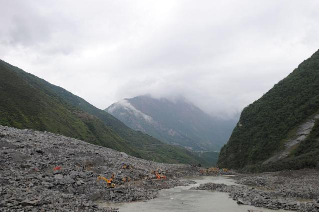 <p>Rescue workers search for survivors at the site of a landslide that occurred in Xinmo Village, Mao County, Sichuan province, China June 24, 2017. (Photo: Stringer/Reuters) </p>