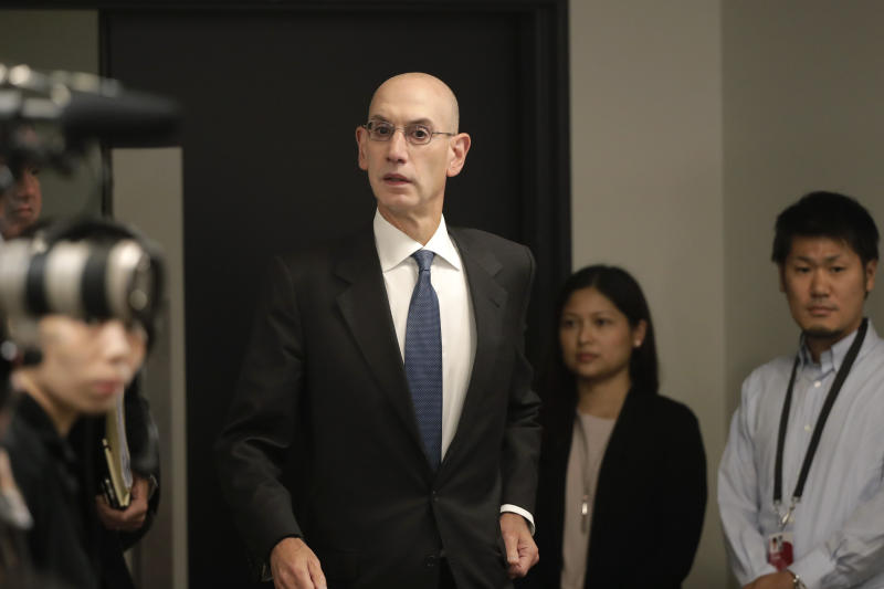 NBA Commissioner Adam Silver arrives for a news conference before an NBA preseason basketball game between the Houston Rockets and the Toronto Raptors Tuesday, Oct. 8, 2019, in Saitama, near Tokyo. (AP Photo/Jae C. Hong)
