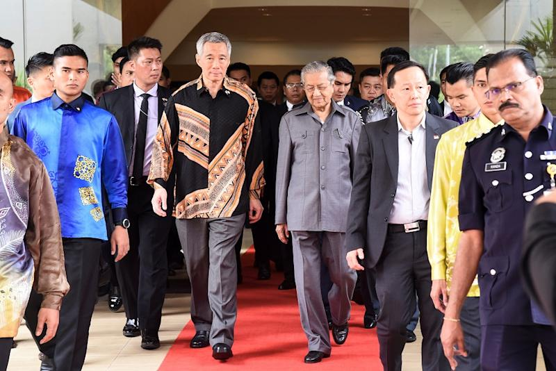 Singapore's Prime Minister Lee Hsien Loong walks with Prime Minister Tun Dr Mahathir Mohamad prior to their private meeting in Putrajaya May 19, 2018. — Reuters pic