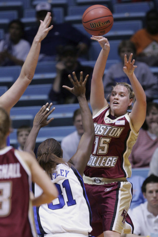 FILE - In this March 22, 2005, file photo, Boston College's Clare Droesch (15) passes over Duke's Wynter Whitley (31) in the first half of the second round of the Women's NCAA college basketball tournament in Chapel Hill, N.C. Former Boston College women's basketball star Droesch died on Friday, May 11, 2018, after a six-year battle with breast cancer the school announced. (AP Photo/Gerry Broome, File)