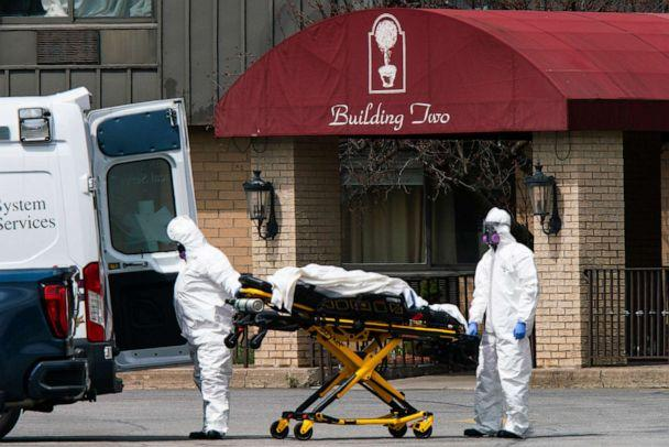 PHOTO: Medical workers load a body into an ambulance at Andover Subacute and Rehabilitation Center on April 16, 2020 in Andover, N.J. (Eduardo Munoz Alvarez/Getty Images, File)