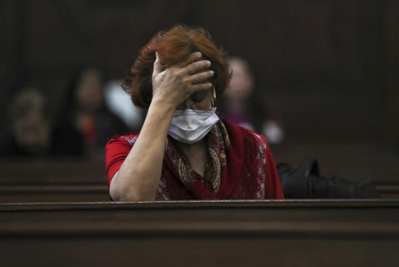 A woman wears a surgical mask as a precaution against the spread of the new coronavirus COVID-19 during a Mass commemorating Ash Wednesday at the Cathedral in Mexico City, Wednesday, Feb. 26, 2020. Ash Wednesday marks the beginning of Lent, a solemn period of 40 days of prayer and self-denial leading up to Easter. (AP Photo/Fernando Llano)