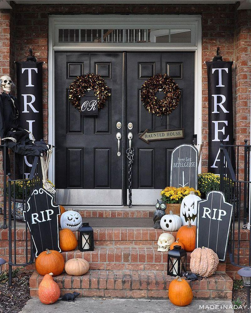 """<p>Take a cue from the haunted houses you've come to know and love with this ghoulish scene. Chalkboard tombstones, tons of pumpkins, and black lanterns add to the theme.</p><p><strong>Get the tutorial at <a href=""""https://madeinaday.com/diy-halloween-chalkboard-tombstones/"""" rel=""""nofollow noopener"""" target=""""_blank"""" data-ylk=""""slk:Made in a Day"""" class=""""link rapid-noclick-resp"""">Made in a Day</a>.</strong></p><p><a class=""""link rapid-noclick-resp"""" href=""""https://go.redirectingat.com?id=74968X1596630&url=https%3A%2F%2Fwww.walmart.com%2Fsearch%2F%3Fquery%3Dhalloween%2Bsigns&sref=https%3A%2F%2Fwww.thepioneerwoman.com%2Fholidays-celebrations%2Fg32894423%2Foutdoor-halloween-decorations%2F"""" rel=""""nofollow noopener"""" target=""""_blank"""" data-ylk=""""slk:SHOP HALLOWEEN SIGNS"""">SHOP HALLOWEEN SIGNS</a></p>"""