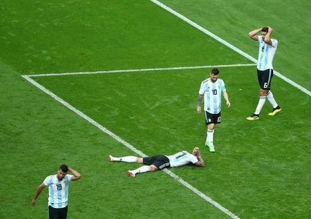 Soccer Football - World Cup - Round of 16 - France vs Argentina - Kazan Arena, Kazan, Russia - June 30, 2018 Argentina's Lionel Messi, Nicolas Otamendi, Sergio Aguero and Federico Fazio look dejected at the end of the match REUTERS/Pilar Olivares