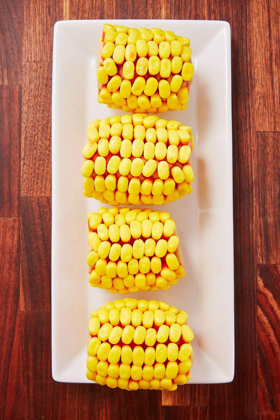 "<p>This crazy treat is made of EDIBLE sugar cookie dough!!</p><p>Get the recipe from <a href=""https://www.delish.com/holiday-recipes/halloween/a28700347/candy-corn-cob-recipe/"" rel=""nofollow noopener"" target=""_blank"" data-ylk=""slk:Delish"" class=""link rapid-noclick-resp"">Delish</a>.</p>"