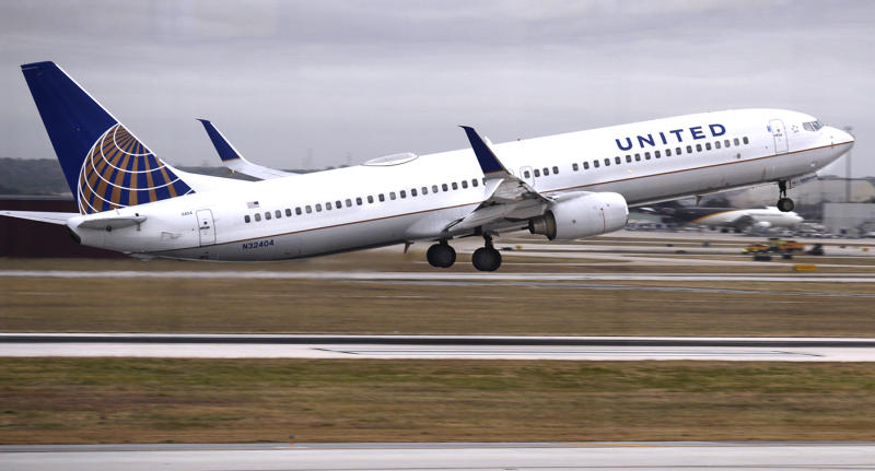 A united airlines flight takes off.