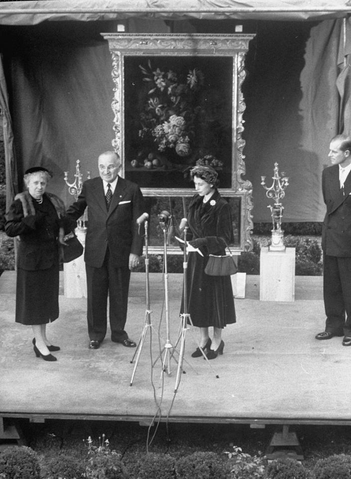 <p>Here they are exchanging gifts in the rose garden of the White House on that same visit.</p>