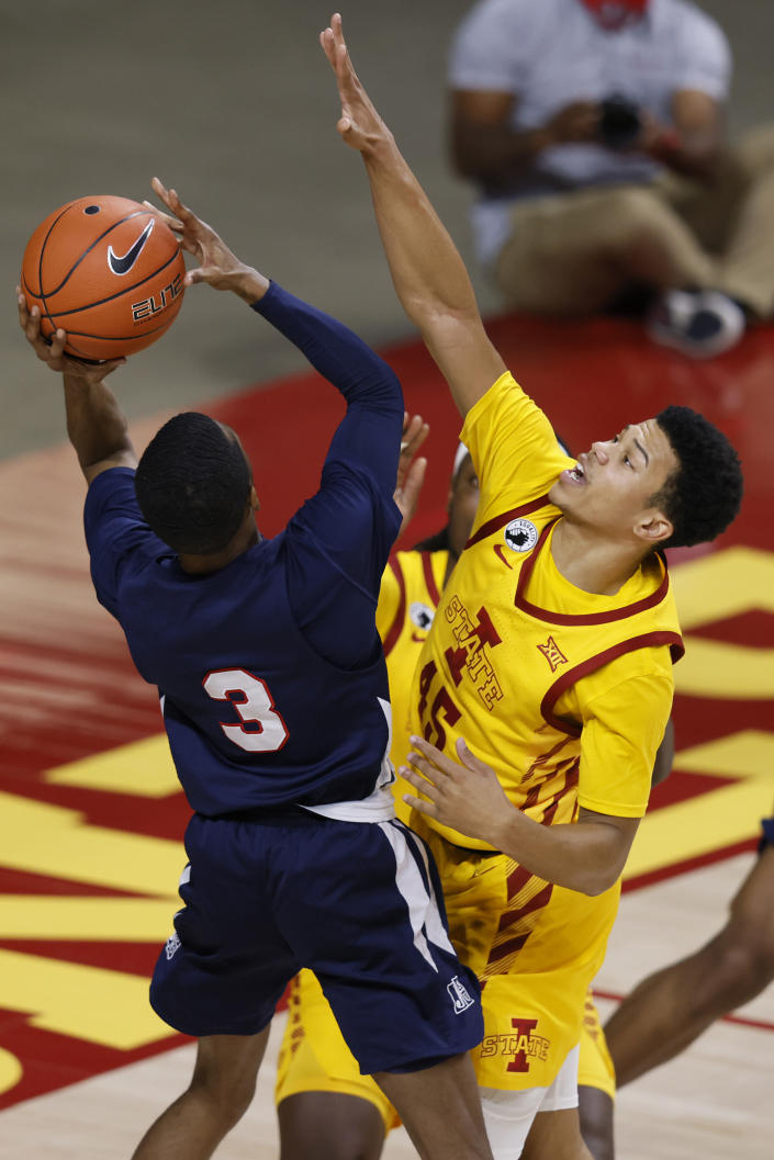 Jackson State guard Jonas James, left, shoots as Iowa State guard Rasir Bolton, right, defends during the first half of an NCAA college basketball game, Sunday, Dec. 20, 2020, in Ames, Iowa. (AP Photo/Matthew Putney)