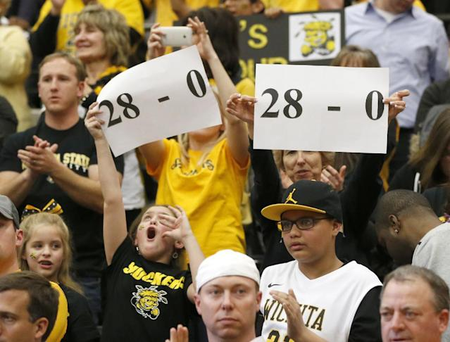 Wichita State fans celebrate their team 88-74 win over Loyola of Chicago during the second half of an NCAA college basketball game Wednesday, Feb. 19, 2014, in Chicago. (AP Photo/Charles Rex Arbogast)