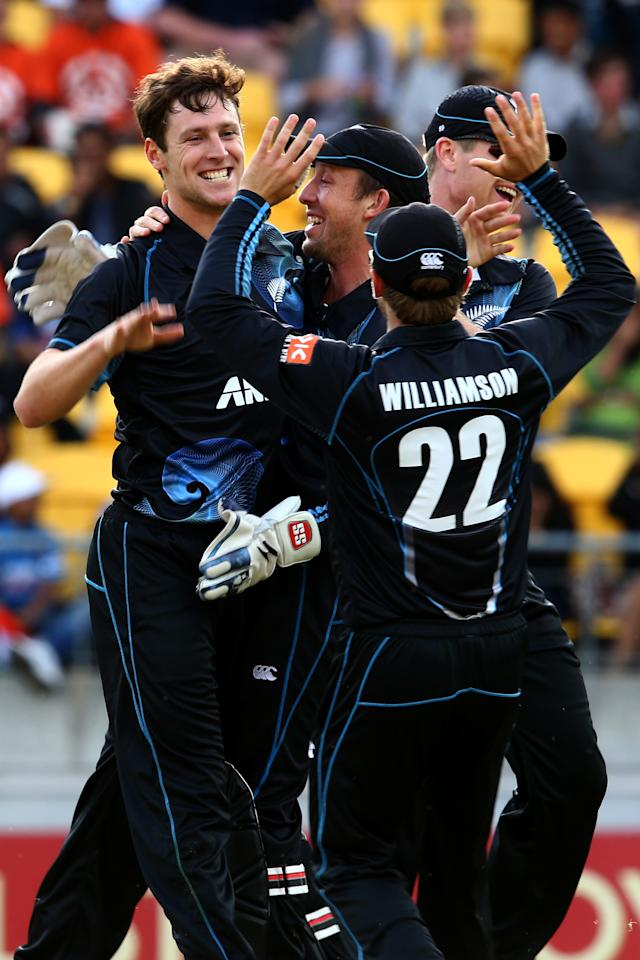WELLINGTON, NEW ZEALAND - JANUARY 31:  Matt Henry of New Zealand (C) celebrates his wicket of Shikhar Dhawan of India with Kane Williamson and Luke Ronchi during Game 5 of the men's one day international between New Zealand and India at Westpac Stadium on January 31, 2014 in Wellington, New Zealand.  (Photo by Phil Walter/Getty Images)