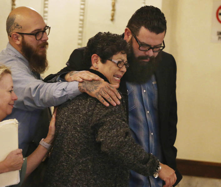 """Christopher """"Jake"""" Carrizal, right, the McLennan County court room with his mother Sonia, left, following a mistrial, Friday, Nov. 10, 2017, in Waco, Texas. The Dallas chapter president of the Bandidos motorcycle club is the first to stand trial involving the 2015 shootout where nine people were fatally shot and 18 people were injured outside of Twin Peaks restaurant. (Rod Aydelotte/Waco Tribune-Herald via AP)"""