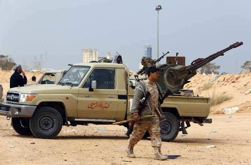 Members of forces loyal to Libya's Islamist-backed parliament General National Congress prepare to launch attacks as they continue to fight Islamic State jihadists on the outskirts of Libya's western city of Sirte on March 16, 2015