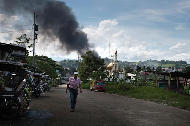 <p>Smoke billows from the city center after an air attack by Philippine government troops on May 30, 2017 in Marawi city, southern Philippines. (Jes Aznar/Getty Images) </p>
