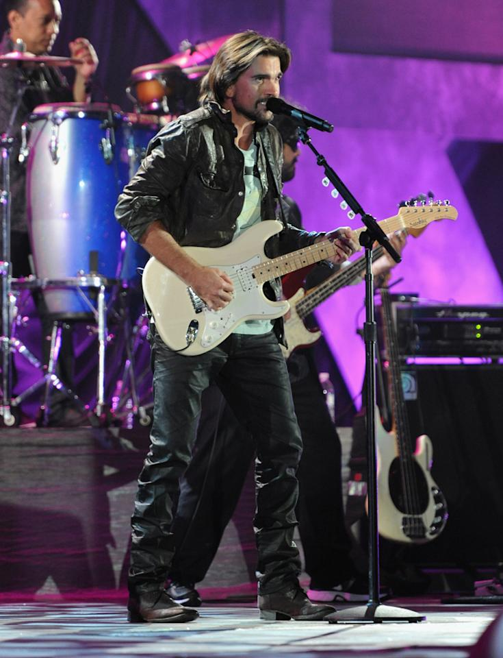 Juanes performs at A Decade of Difference: A Concert Celebrating 10 Years of the William J. Clinton Foundation on October 15, 2011, at the Hollywood Bowl, Los Angeles. <br><br>(Photo by Handout/Getty Images for Control Room)