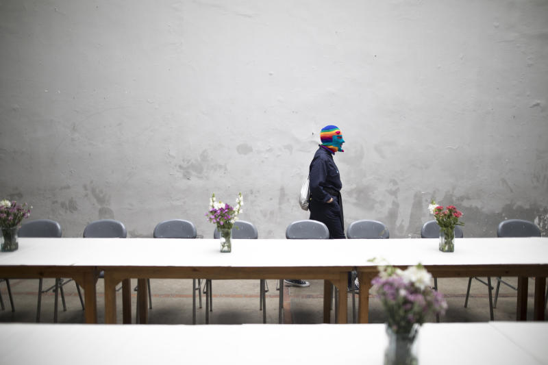 """A member of the Brazilian theater group Clowns of Shakespeare wears his costume before performing in Bogota, Colombia, Saturday, Oct. 26, 2019. The troupe's play titled """"Abrazo,"""" or Hug, is among the growing list of shows, plays, conferences and other artistic projects that have been abruptly canceled in Brazil since the nation's President Jair Bolsonaro took office Jan. 1, after the troupe talked politics with the audience during the show's debut. (AP Photo/Ivan Valencia)"""