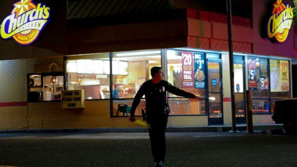 PHOTO: San Diego Police officers seal off the area around a Church's Chicken eatery in San Diego after a shooting on Nov. 6, 2019. (Nelvin C. Cepeda/The San Diego Union-Tribune via Newscom)