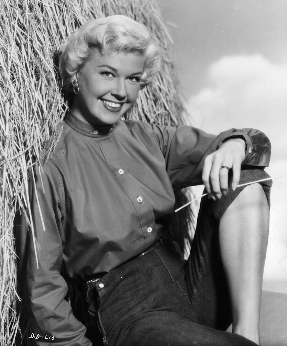 <p>Likewise, actress Doris Day also wore jeans in her similarly western-inspired promotional image that Warner Brothers commissioned.</p>