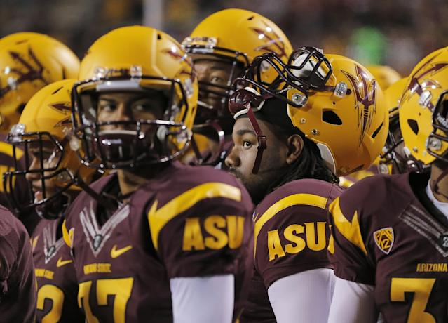 Arizona State players watch the final seconds of the NCAA Pac-12 Championship football game against Stanford, Saturday, Dec. 7, 2013, in Tempe, Ariz. Stanford won 38-14.(AP Photo/Matt York)