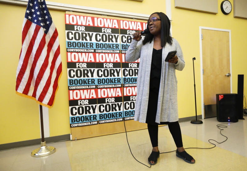 Former chairwoman of the Iowa Democratic Black Caucus Jamie Woods introduces Democratic presidential candidate Sen. Cory Booker to speak during the Iowa Democratic Party Black Caucus Reception, Tuesday, April 16, 2019, in Des Moines, Iowa. In Iowa _ that's right _ black Democrats are more energized than they've been since Barack Obama's 2008 presidential campaign and are poised to make a mark on the 2020 race. (AP Photo/Charlie Neibergall)