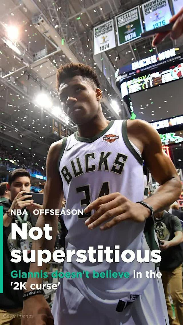 Giannis Antetokounmpo doesn't believe in the '2K curse,' does believe he'll be a 'Buck for life'.