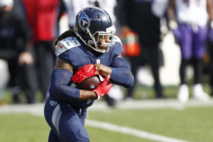 Tennessee Titans running back Derrick Henry carries the ball against the Baltimore Ravens in the first half of an NFL wild-card playoff football game Sunday, Jan. 10, 2021, in Nashville, Tenn. (AP Photo/Wade Payne)