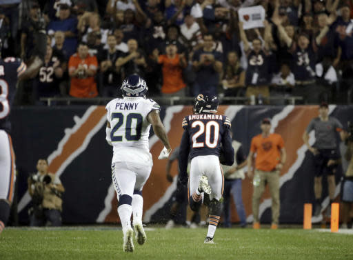 Chicago Bears defensive back Prince Amukamara (20) runs tot he end zone for a touchdown after intercepting a pass intended for Seattle Seahawks running back Rashaad Penny (20) during the second half of an NFL football game Monday, Sept. 17, 2018, in Chicago. (AP Photo/Nam Y. Huh)