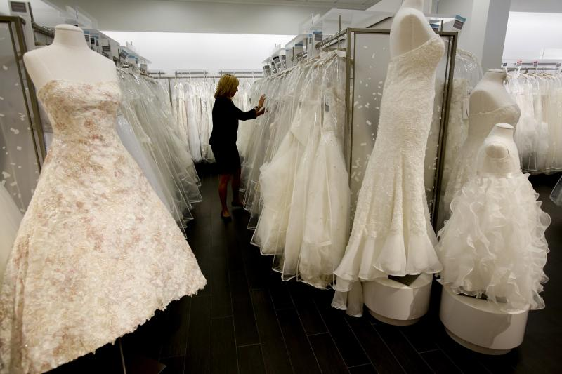 Store manager Sonni Sanders (CQ) looks for gowns for customers to try on at David's Bridal which opened its first upscale boutique in the country in Los Angeles on West Pico Boulevard.