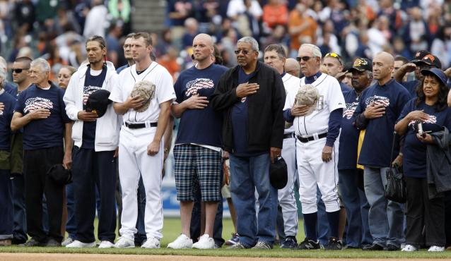 DETROIT, MI - MAY 27: Max Scherzer #37 of the Detroit Tigers and manager Jim Leyland #10 stand with veterans during the playing of the Nation Anthem before an interleague game against the Pittsburgh Pirates at Comerica Park on May 27, 2013 in Detroit, Michigan. The Detroit Tigers and Major League Baseball paid tribute to the armed forces during their Memorial Day games. (Photo by Duane Burleson/Getty Images)